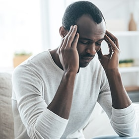 A gentleman who's experiencing constant migraines because of TMJ pain