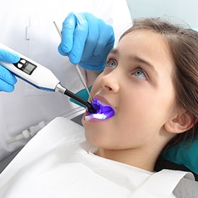 Child patient getting sealants to prevent future tooth decay