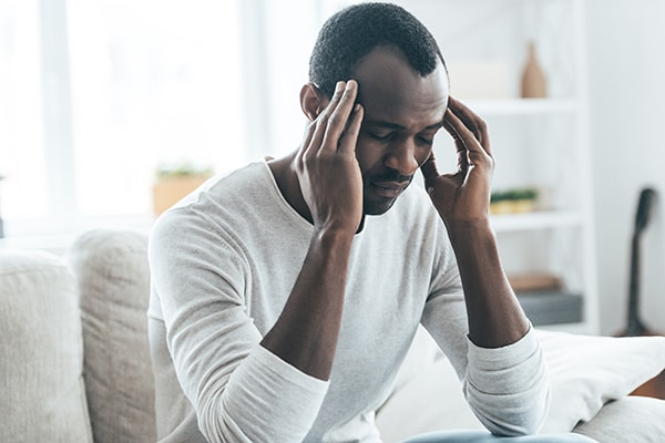 A older gentleman who has constant headaches and is in need of TMJ treatment