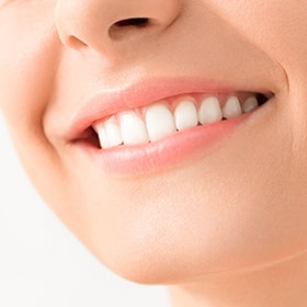 A patient with healthy gums after periodontal therapy