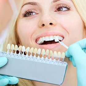A female patient getting teeth whitening