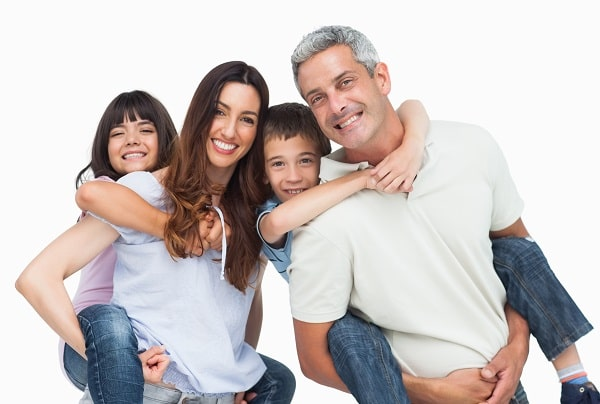 Mom, Dad, son, and daughter, all with healthy smiles because of our Peoria dental services.